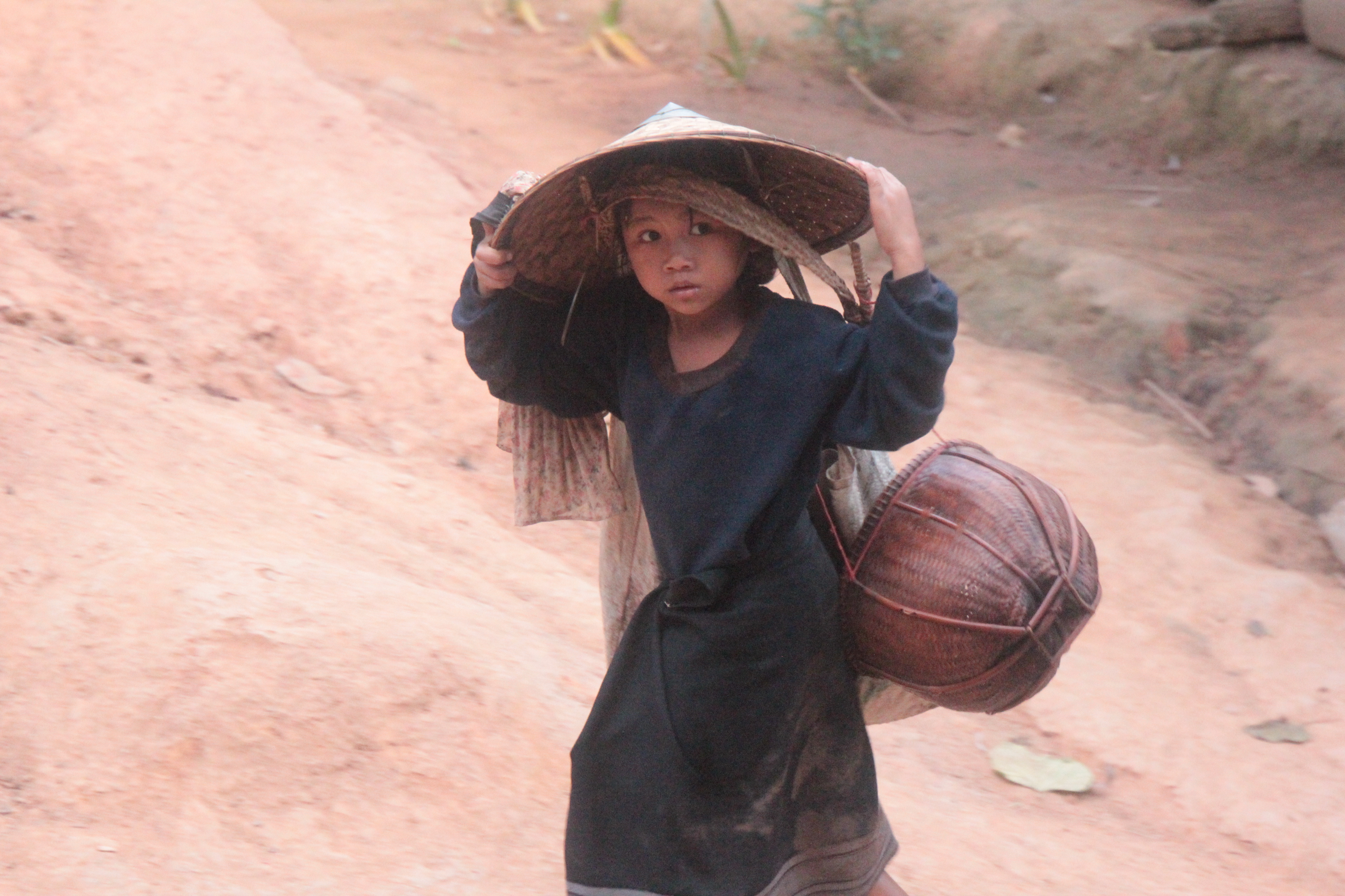 Girl carrying rice 2
